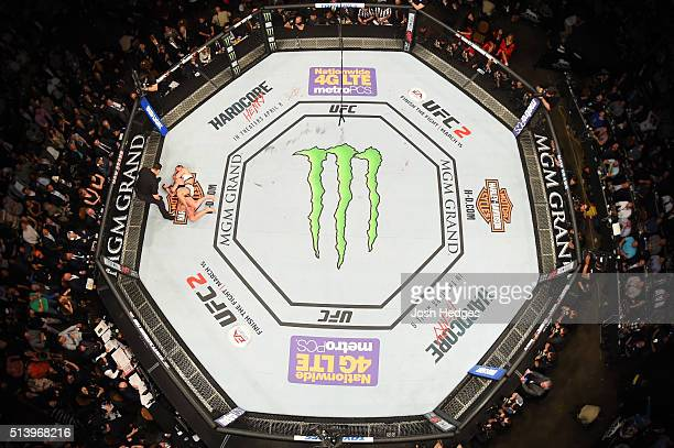 An overhead view of the Octagon as Miesha Tate attempts to submit Holly Holm in their UFC women's bantamweight championship bout during the UFC 196...