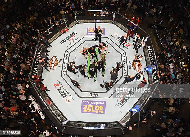 An overhead view of the Octagon as Miesha Tate reacts to her victory over Holly Holm in their UFC women's bantamweight championship bout during the...