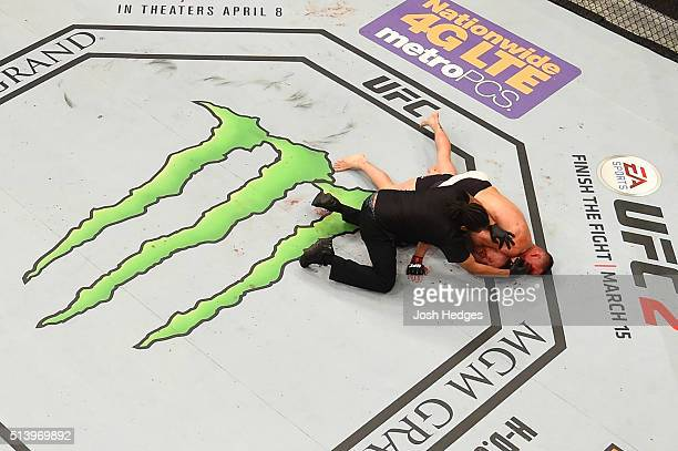 An overhead view of the Octagon as Nate Diaz attempts to submit Conor McGregor of Ireland in their welterweight bout during the UFC 196 event inside...