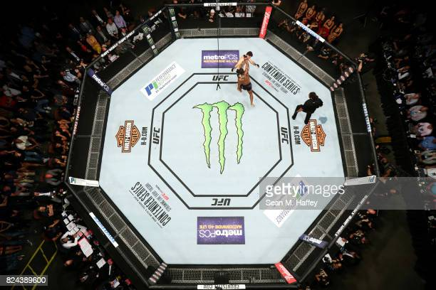 An overhead view of the Octagon as Tyron Woodley punches Demian Maia of Brazil in their UFC Welterweight Championship bout during the UFC 214 event...