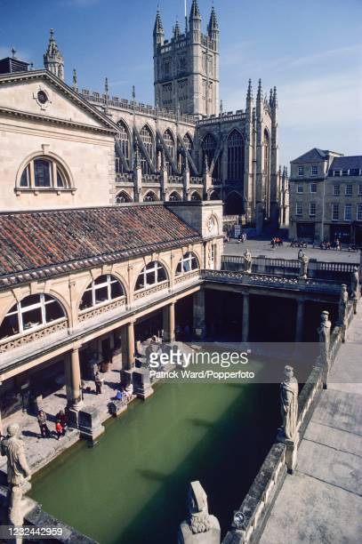 An overhead view of the Roman Baths with Bath Abbey beyond at Bath in Somerset, circa May 1985.