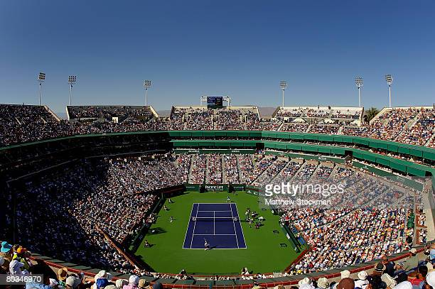 An overhead view of the stadium as Mardy Fish serves to Roger Federer of Switzerland during the men's semi final at the Pacific Life Open at the...