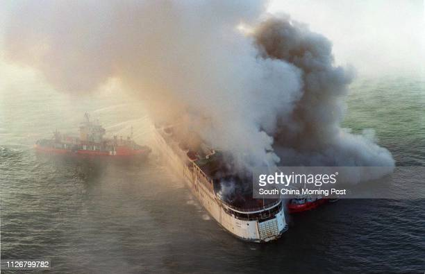 An overhead view see the marine police continues battling the blaze on the 5000tonne Hondurasregistered passenger ship Zenith anchored off Siu Kau Yi...