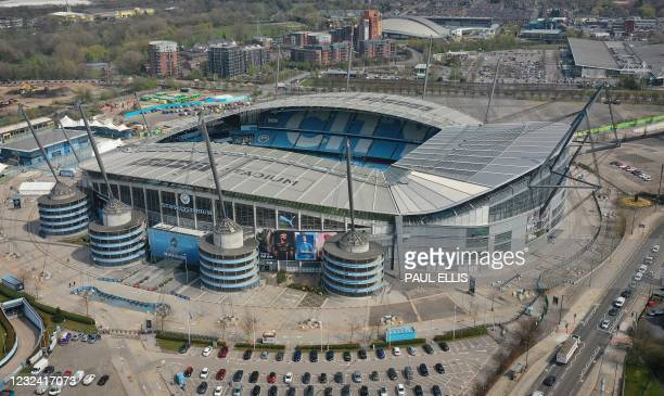 An overhead view shows English Premier League football club Manchester City's Etihad stadium within the Etihad Campus in Manchester, north-west...