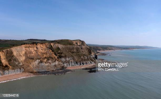 An overhead view shows the scene of a coastal cliff fall on Dorset's Jurassic Coast near the village of Seatown, on the south west coast of England...
