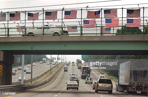 An overpass on Rt 128 is adorned with American flags as traffic flows on the anniversary of the terrorist attacks