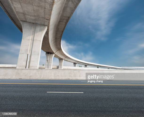 an overpass on the highway to the city - turning stock pictures, royalty-free photos & images