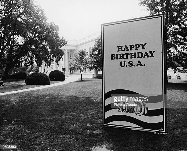 An oversized birthday card honoring the American Bicentennial stands on display on the White House lawn Washington DC July 3 1976