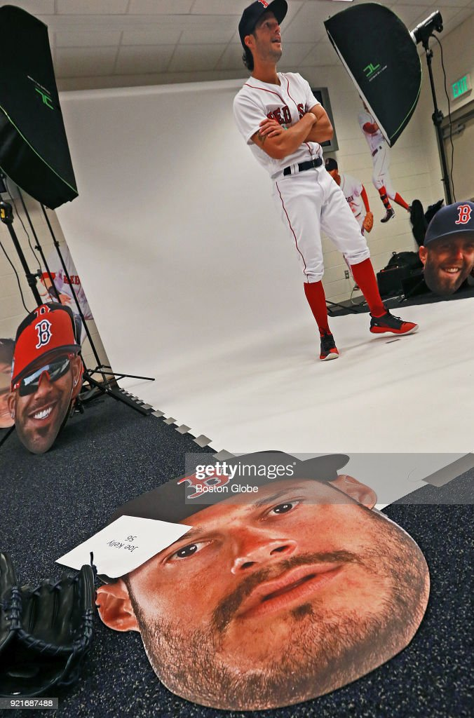 An oversized cutout of Boston Red Sox pitcher Joe Kelly lays on the ground as he poses for promotional photos during spring training at the Player Development Complex at Jet Blue Park in Fort Myers, FL on Feb. 20, 2018.