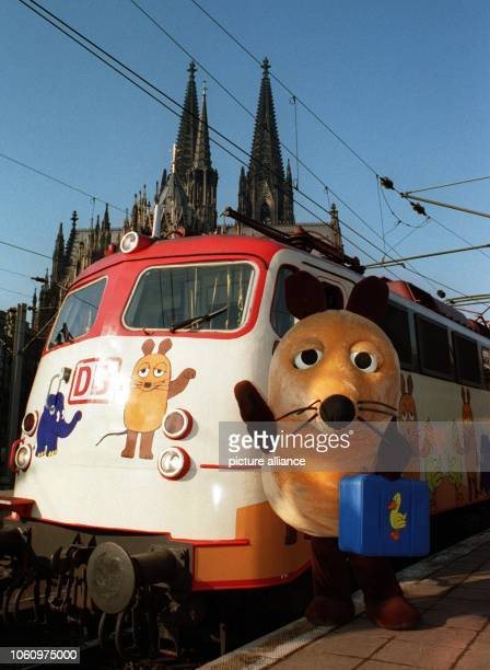 An oversized figure of the Mouse presents the socalled 'MouseTrain' in Cologne on the 23rd of February in 1996 on the occasion of the 25th birthday...