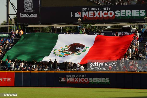 An oversized Mexican flag is seen in the stands prior to the game between the St Louis Cardinals and the Cincinnati Reds at Estadio de Beisbol...