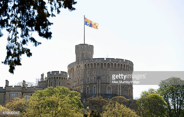 An oversized Royal Standard flies above the Round Tower of Windsor Castle to mark Queen Elizabeth II's 89th Birthday on April 21 2015 in Windsor...