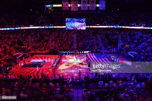 An oversized US flag is brought onto the court as part of the pregame ritual prior to the start of the game as the Connecticut Sun host the Phoenix...