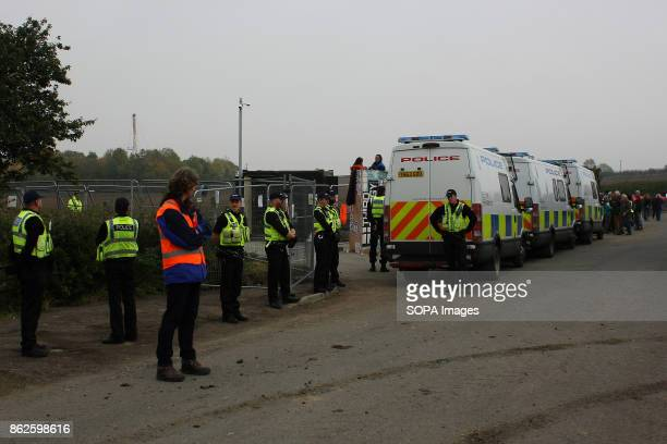 An overtly heavy police presence forms a cordon around the gates of a Frack company Third Energy's Fracking Site as Anti Fracking protestors lockon...