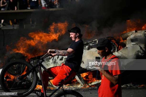 An overturned police cruiser burns as protestors clash with police near City Hall in Philadelphia PA on May 30 2020 Cities around the nation see...