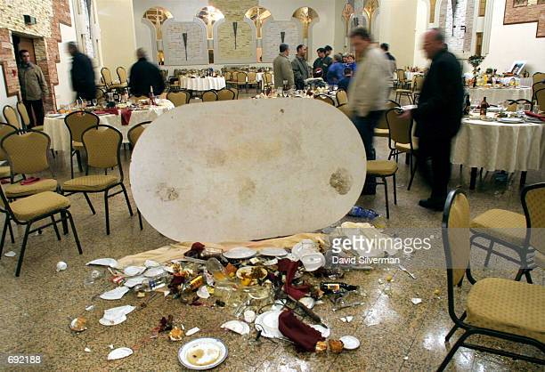 An overturned table its contents shattered on the marble floor bears silent witness to the violent end to Nina Kardashovs bat mitzvah the Jewish...