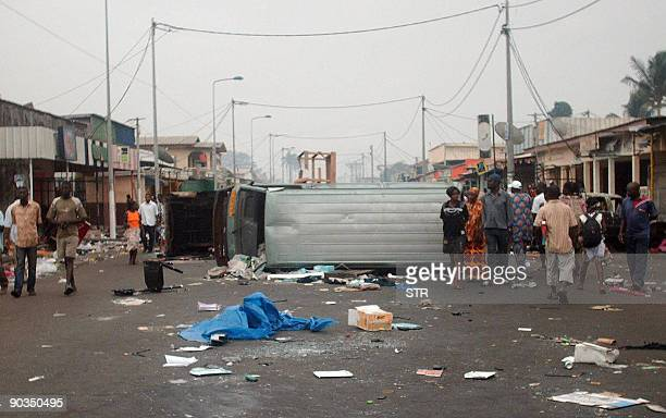 An overturned vehicle is part of a makeshift barricade which was erected on September 5 2009 in the second city of Port Gentil on a main road leading...