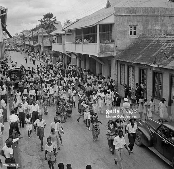 An overview of a busy street during a carnival in Port of Spain, Trinidad, British West Indies.