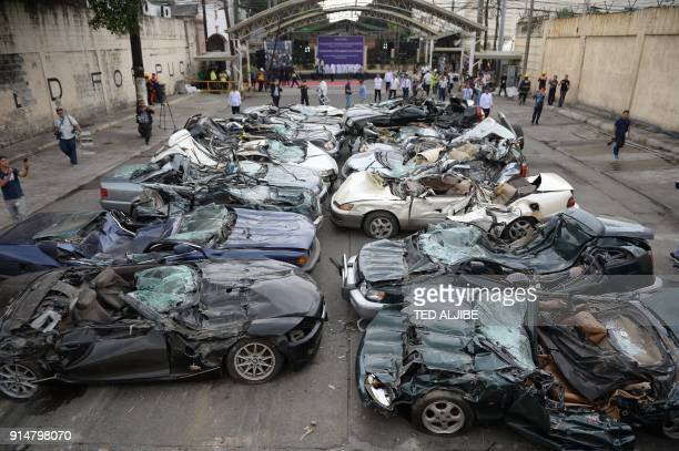 An overview of crushed luxury vehicles at a ceremony at the customs yard in Manila on February 6 after they were seized for being smuggled illegally...