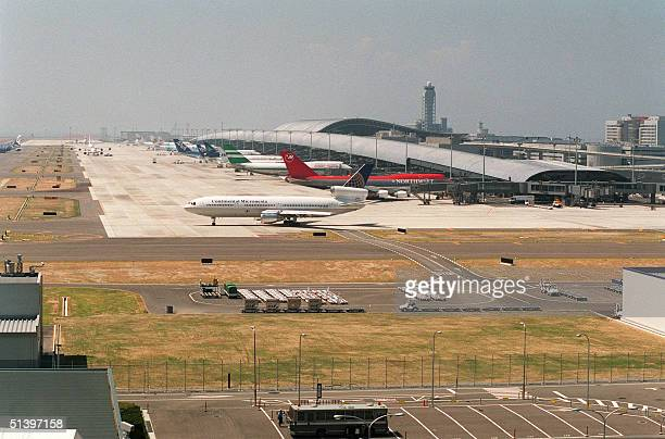 An overview of Japan's Kansai International airport a 511hectare manmade island in Osaka Bay located fivekilometers off the coast Japan's first...