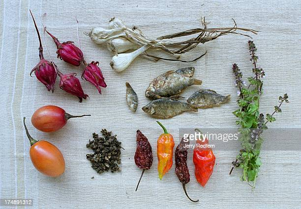 An overview of key ingredients in traditional Naga cooking from top left roselle flower garlic salted fish local green herbs both fresh and dried...