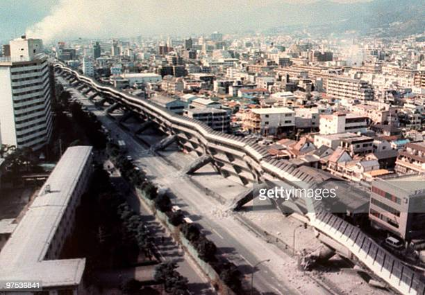 An overview of Nishinomiye area of Kobe taken 17 January 1995 shows a collapsed elevated highway as powerful earthquake measuring 702 on the Richter...