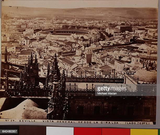 An overview of Seville from Giralda Cathedral. Spain, ca. 1880s-1890s.