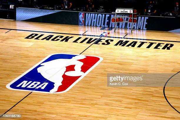 An overview of the basketball court shows the NBA logo and Black Lives Matter before the start of a game between the Denver Nuggets and the Miami...