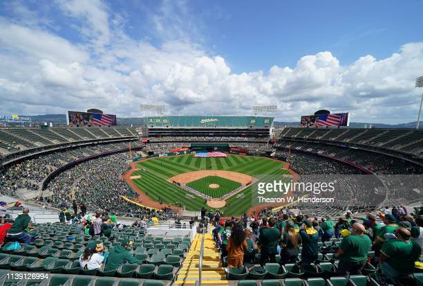 An overview of the Coliseum while the Los Angeles Angels of Anaheim and Oakland Athletics stands for the National Anthem on Opening Day of Majoar...
