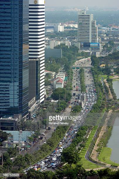 An overview of the congested Rachada boulevard in central Bangkok which goes along the lake at the Queen Sirikit park