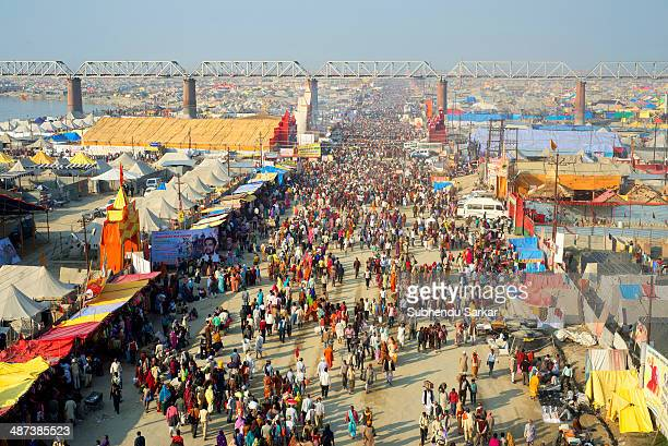 An overview of the crowd at Maha Kumbh mela. Kumbh Mela is a site of mass pilgrimage in which Hindus gather at a sacred river for a holy dip. It is...
