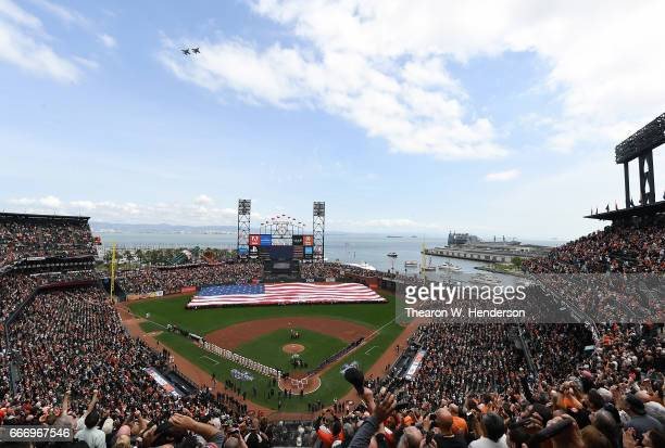 An overview of the inside of ATT Park as the Arizona Diamondbacks and San Francisco Giants stand for the National Anthem prior to the start of their...
