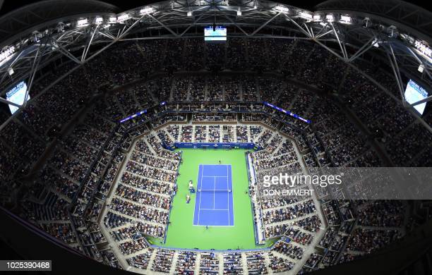 An overview of the stadium shows Novak Djokovic of Serbia and Tennys Sandgren of the US meeting during their 2018 US Open men's round 2 tennis match...