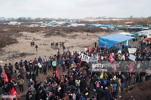 An overview of the start of the refugees welcome march in solidarity with and by the refugees residing in the refugee camp the jungle of Calais