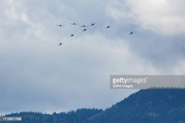 An overview of United States Air Force F-16 fighter planes and Slovenian Air Force PC-9 planes in two echelon formations as they fly over Slovenia....