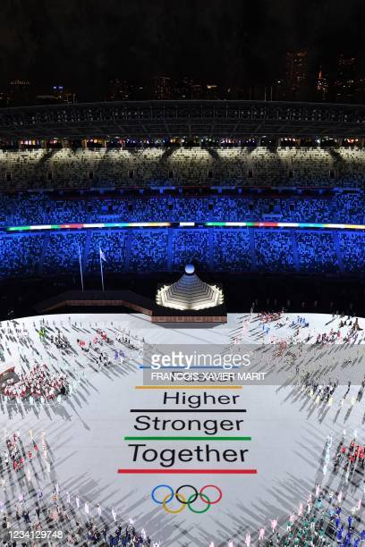 An overview shows athlete delegations taking part in the opening ceremony of the Tokyo 2020 Olympic Games, at the Olympic Stadium, in Tokyo, on July...