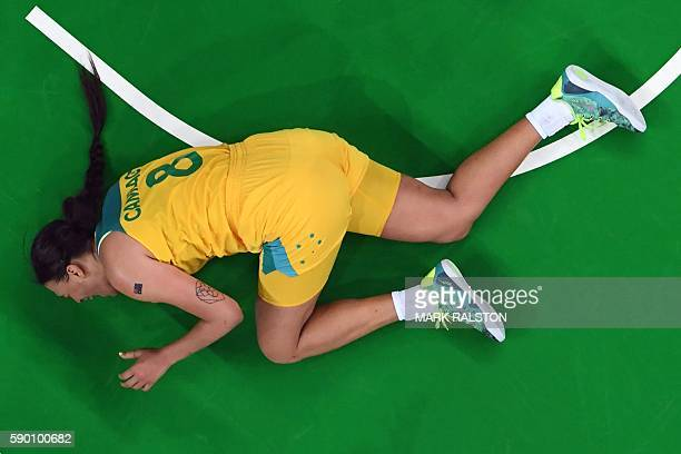 An overview shows Australia's centre Elizabeth Cambage fall during a Women's quarterfinal basketball match between Australia and Serbia at the...