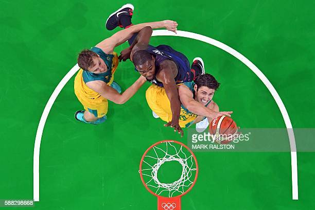 An overview shows Australia's guard Damian Martin and USA's guard Kevin Durant go for a rebound during a Men's round Group A basketball match between...