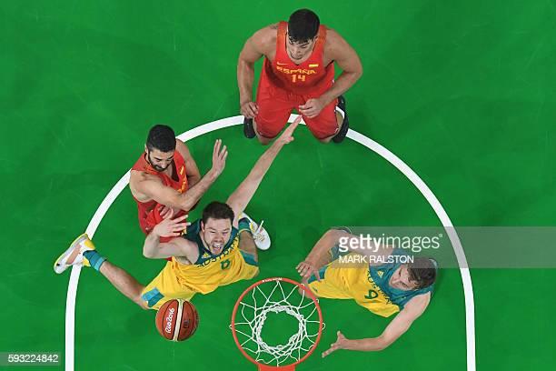 An overview shows Australia's guard Matthew Dellavedova blocking Spain's guard Juan-Carlos Navarro during a Men's Bronze medal basketball match...