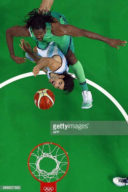 An overview shows Brazil's centre Nene Hilario and Argentina's power forward Luis Scola go for a rebound during a Men's round Group B basketball...