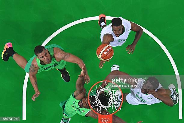 An overview shows Brazil's centre Nene Hilario and Nigeria's power forward Ike Diogu go for a rebound during a Men's round Group B basketball match...