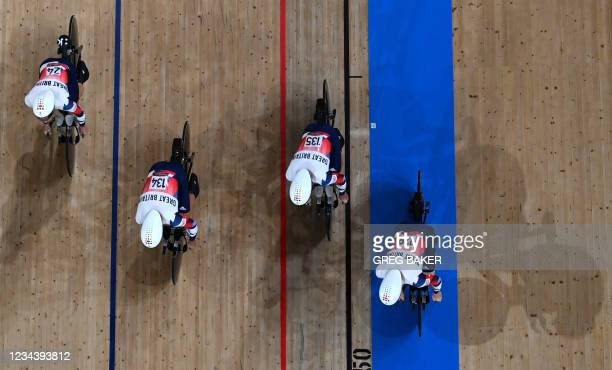 An overview shows Britain's Ethan Hayter, Britain's Ethan Vernon, Britain's Oliver Wood and Britain's Edward Clancy competing in the men's track...