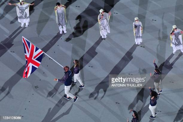 An overview shows Britain's flag bearers Hannah Mills and Mohamed Sbihi leading their delegation as they enter the Olympic Stadium during the opening...