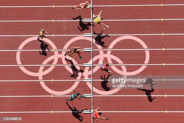 An overview shows Canada's Damian Warner as he competes to first place in the men's decathlon 110m hurdles during the Tokyo 2020 Olympic Games at the...