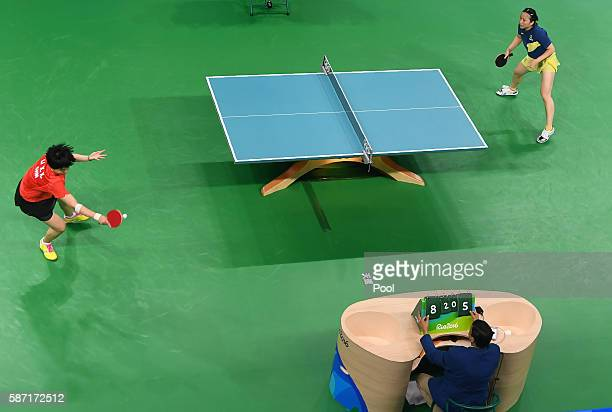 An overview shows China's Li Xiaoxia playing against Sweden's Li Fen in their women's singles qualification round table tennis match at the Riocentro...