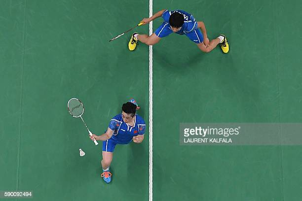 An overview shows China's Tang Yuanting and China's Yu Yang return against Denmark's Christinna Pedersen and Denmark's Kamilla Rytter Juhl during...