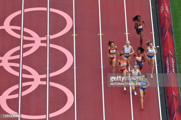 An overview shows China's Wang Chunyu, Spain's Natalia Romero, Britain's Jemma Reekie, USA's Ajee Wilson and Italy's Elena Bello compete in the...