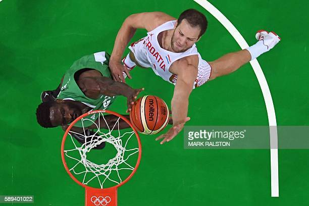 An overview shows Croatia's shooting guard Bojan Bogdanovic and Nigeria's centre Ekene Ibekwe go for a rebound during a Men's round Group B...