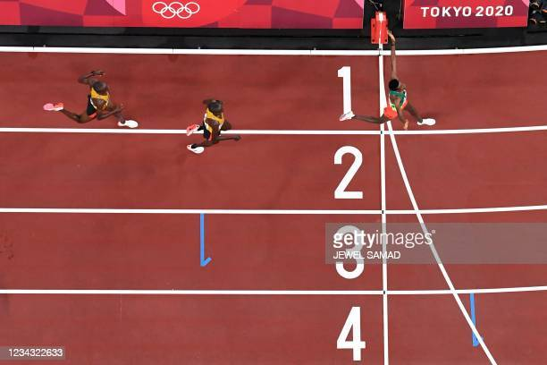 An overview shows Ethiopia's Selemon Barega as he crosses the finish to win ahead of second-placed Uganda's Joshua Cheptegei and third-placed...