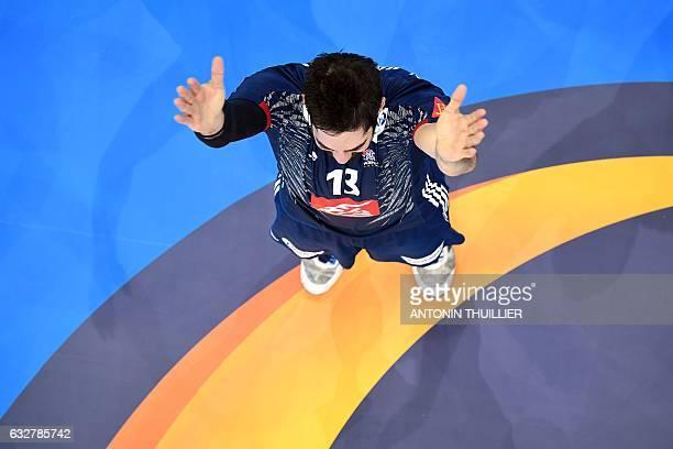 TOPSHOT An overview shows France's centre back Nikola Karabatic react after France won the 25th IHF Men's World Championship 2017 semifinal handball...